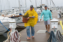 October 7, 2016 - Mt Pleasant, United States - Live aboard boaters clear out belongings at the Patriots Point Marina on Charleston Harbor in preparation for Hurricane Matthew October 7, 2016 in Mt Pleasant, South Carolina. The hurricane is expected to make landfall near Charleston as a Category 2 storm with strong winds, rain and storm serge. (Credit Image: © Richard Ellis via ZUMA Wire)