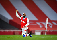 Football - 2019 / 2020 Premier League - Arsenal vs. Leicester City<br /> <br /> Arsenal's Alexandre Lacazette takes the knee before the game for Black Lives Matter, at the Emirates Stadium.<br /> <br /> COLORSPORT/ASHLEY WESTERN