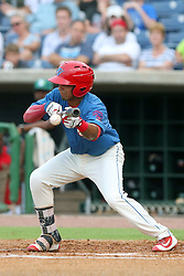 July 17, 2018 - Clearwater, FL, U.S. - TAMPA, FL - JULY 17: Raul Rivas (13) of the Threshers lays down a bunt for a hit during the Florida State League game between the Daytona Tortugas and the Clearwater Threshers on July 17, 2018, at Spectrum Field in Clearwater, FL. (Photo by Cliff Welch/Icon Sportswire) (Credit Image: © Cliff Welch/Icon SMI via ZUMA Press)