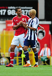 Bristol City's Lewin Nyatanga shares a joke with West Bromwich Albion's Peter Odemwingie   - Photo mandatory by-line: Joseph Meredith / JMPUK - 30/07/2011 - SPORT - FOOTBALL - Championship - Bristol City v West Bromwich Albion - Ashton Gate Stadium, Bristol, England