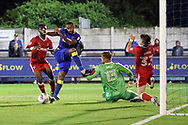 AFC Wimbledon midfielder Liam Trotter (14) with a shot on goal during the EFL Sky Bet League 1 match between AFC Wimbledon and Gillingham at the Cherry Red Records Stadium, Kingston, England on 12 September 2017. Photo by Matthew Redman.