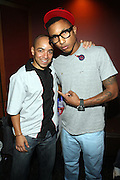l to r: Derek Dudley and Pharell at Common's Start the Show n' Bowl benefiting The Common Ground Foundation held at Hotel Sax on September 26, 2008 in Chicago, IL