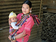 Portrait of a young Kayaw ethnic minority woman and her baby in the village of Yo Co Pra village in Kayah State, Myanmar on 21st November 2016. Myanmar is one of the most ethnically diverse countries in Southeast Asia with 135 different indigenous ethnic groups with over a dozen ethnic Karenni subgroups in the Kayah region