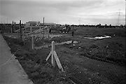 24/09/1963<br /> 09/24/1963<br /> 24 September 1963<br /> Brittain's new site at the Long Mile Road, Dublin. View at beginning of construction, as bulldozers level the site. in background is premises of Aspro Nicholas.
