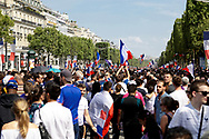 Crowd and flags during the parade of the team France on Champ-Elysées after winning the 2018 FIFA World Cup Russia on July 16, 2018 in Paris, France - Photo Frederic Le Floc'h / ProSportsImages / DPPI