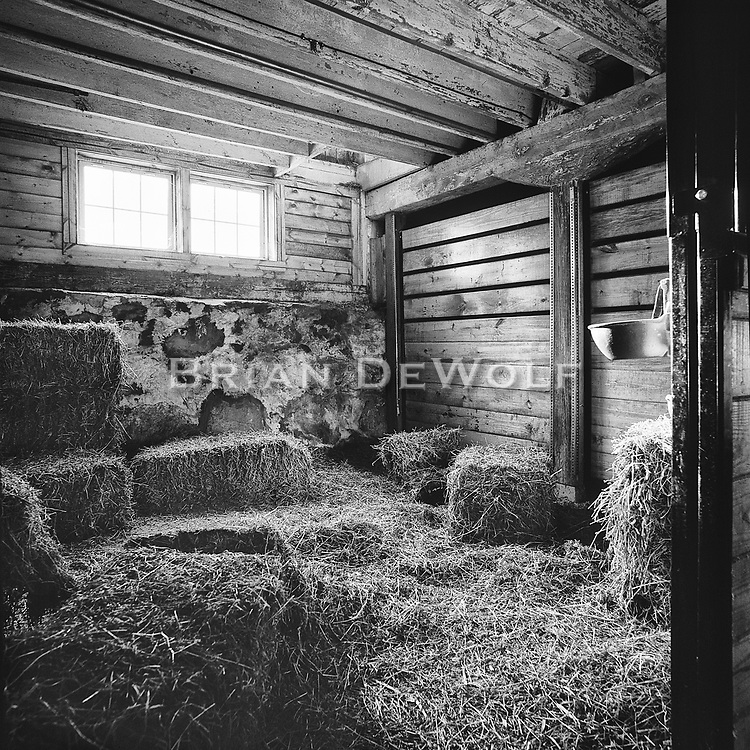 Used for storing straw, this stall almos looks inviting as a resting place.   Aspect Ratio 1w x 1h