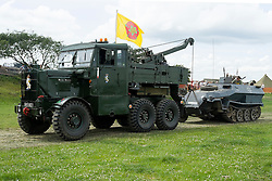 Magda the Sd.Kfz 251AufC Halftrack with wheel missing hooked up to Dooleys Dragster and ready to be towed from the Yorkshire Wartime Experience Arena at Hunsworth Lane Hunsworth West Yorkshire where  the where the recent AA Commercial she appeared in was filmed.<br /> <br /> 05 July 2015<br />  Image © Paul David Drabble <br />  www.pauldaviddrabble.co.uk