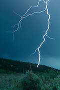 Lightning strikes a hillside near Jackson, Wyoming, during a severe thunderstorm.