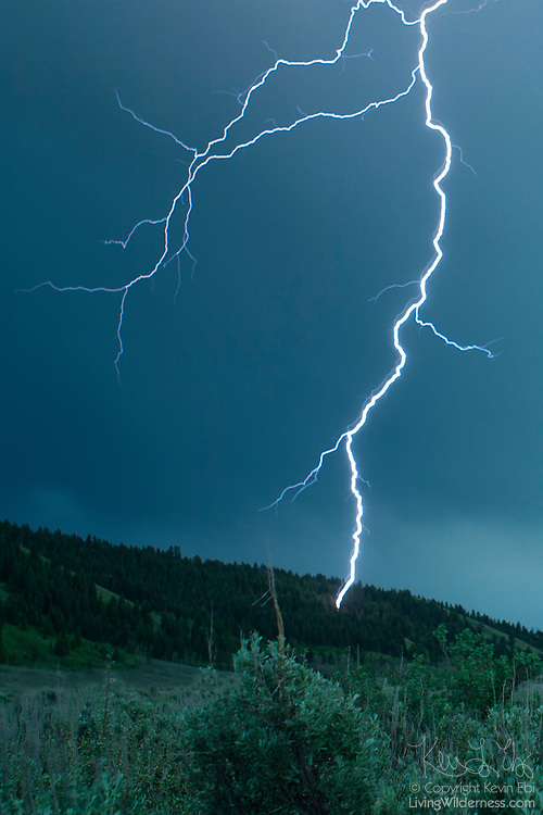 Lightning strikes a hillside near Jackson, Wyoming, during a severe thunderstorm.