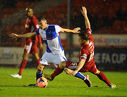 Bristol Rovers' Ollie Clarke looks to goes past Crawley Town's Dannie Bulman - Photo mandatory by-line: Seb Daly/JMP - Tel: Mobile: 07966 386802 18/12/2013 - SPORT - FOOTBALL - Broadfield Stadium - Crawley - Crawley Town v Bristol Rovers - FA Cup - Replay