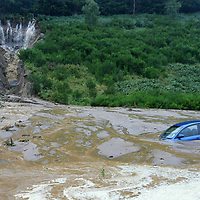 A9 Landslide north of Dunkeld, Perthshire 11.08.04<br />The VW Passat belonging to Sandy Hill from Dundee who had to escape from the car with his family after being engulfed by the landslide.<br />(Please see Gordon Currie story 01738 446766)<br />Picture by Graeme Hart.<br />Copyright Perthshire Picture Agency<br />Tel: 01738 623350  Mobile: 07990 594431