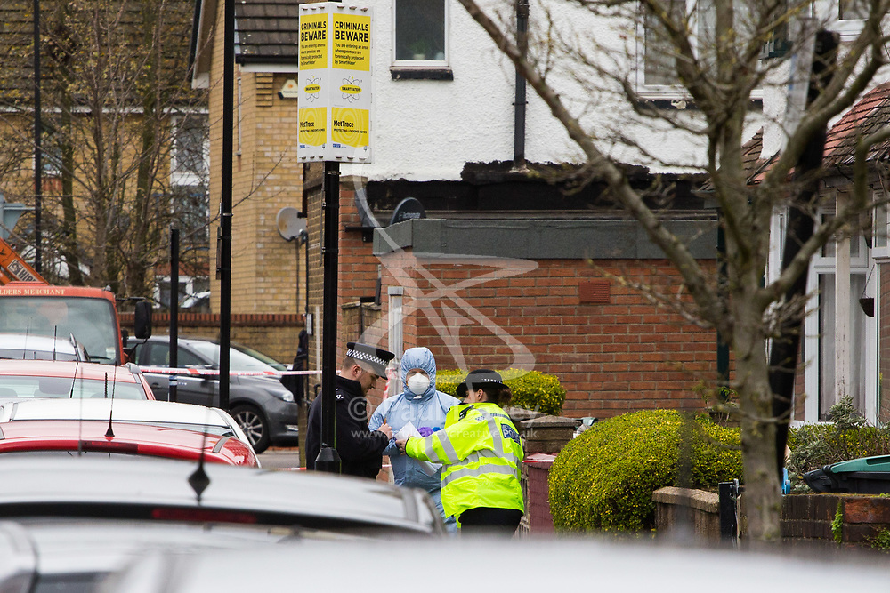 A forensics investigator at the scene in Chalgrove Road, Tottenham, North London, where a seventeen year-old girl was shot dead on the evening of April 2nd. London, April 03 2018.