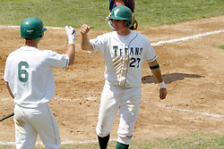 22 April 2006:  ....Titan Nick Chilczenkowski gets a congrats tap from team mate Nate Rittenberry as he scores a run.....In CCIW, Division 3 action, the Titans of Illinois Wesleyan capped the Auggies of Augustana College by a scor of 3-2 in game one of a double card afternoon.  Games were held at Jack Horenberger field on the campus of Illinois Wesleyan University in Bloomington, Illinois