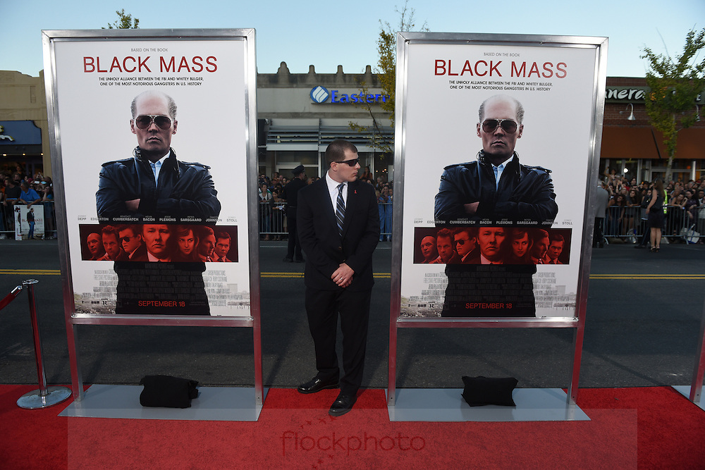 A police detail officer keeps his eye on the red carpet before a special screening of the film Black Mass at the Coolidge Corner Theater in Brookline, Sept. 15, 2015.<br /> Published 9/16/15