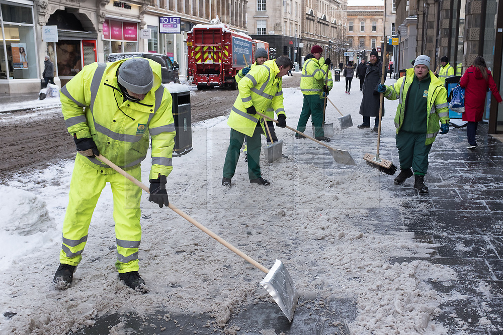 """© Licensed to London News Pictures. 28/02/2018. <br /> <br /> Council workers clear the street in Glasgow, Scotland as the city is hit with snow storm """"Beast from the East"""" on 28th February 2018.<br /> <br /> Photo credit should read Max Bryan/LNP"""