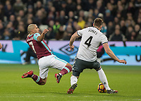 Football - 2016 / 2017 Premier League - West Ham United vs. Manchester United<br /> <br /> Sofiane Feghouli of West Ham with both feet off the floor flies into tackle Phil Jones of Manchester United for which he received a red card at The London Stadium.<br /> <br /> COLORSPORT/DANIEL BEARHAM