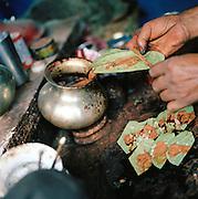 Preparing packets of paan containing Betel nut, Lucknow, Uttar Pradesh, India