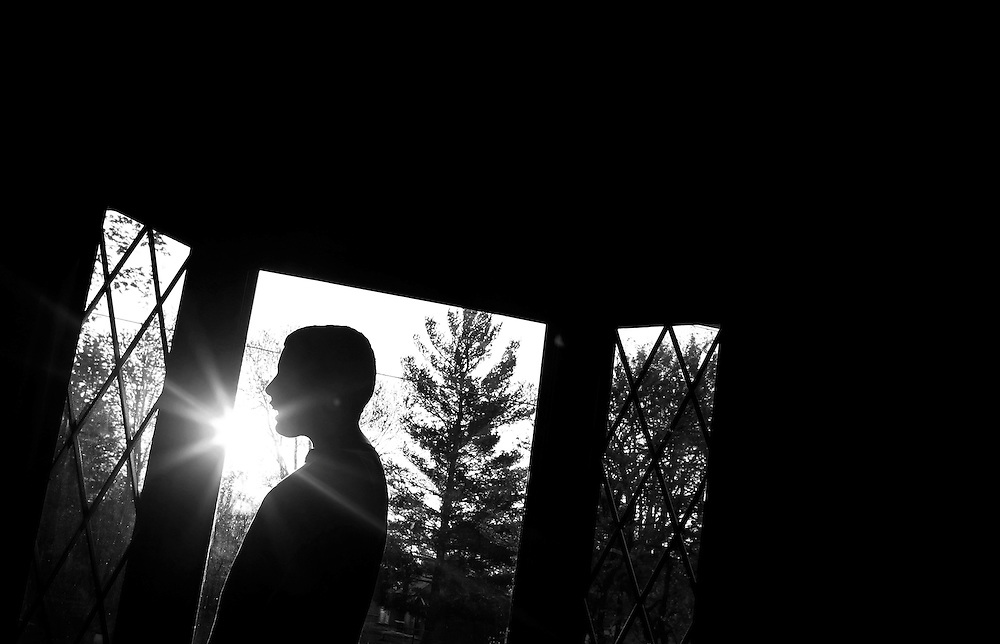 Parker Roos, who suffers from Fragile X, watches television as the sun rises and shines through the window at his home in Canton, Illinois, April 4, 2012. REUTERS/Jim Young