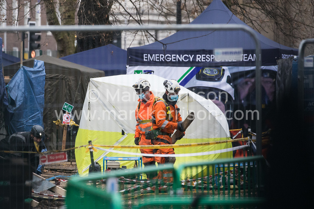 London, UK. 6th February, 2021. National Eviction Team bailiffs take part in an operation to remove environmental activists from anti-HS2 campaign group HS2 Rebellion from tunnels beneath Euston Square Gardens. The activists entered tunnels dug by them beneath the site eleven days ago in order to seek to protect trees from felling in connection with the HS2 high-speed rail project.