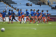The Shrewsbury Town players warm up during the EFL Sky Bet League 1 match between Coventry City and Shrewsbury Town at the Ricoh Arena, Coventry, England on 28 April 2019.