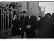 Funeral of Sinead Bean DeValera.    (H82)..1975..09.01.1975..01.09.1975..9th January 1975..Today saw the funeral of Sinead Bean DeValera take place at the Pro Cathedral, Dublin. She was the wife of Ex-President Eamon DeValera. Mrs Devalera was a noted author of childrens literature..Mrs DeValera, Born 3rd June 1878. Died 7th Jan 1975...Picture of Fianna Fail Leader,Jack Lynch (centre), his wife mairin and Chief justice,Tom O'Higgins after the funeral mass at the Pro-Cathedral,Dublin.