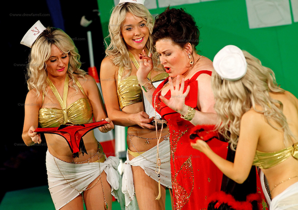 Picture shows : Karen Cargill as Isabella (centre) with bunny girls..Picture  ©  Drew Farrell Tel : 07721 -735041..A new Scottish Opera production of  Rossini's 'The Italian Girl in Algiers' opens at The Theatre Royal Glasgow on Wednesday 21st October 2009..(Soap) opera as you've never seen it before..Tonight on Algiers.....Colin McColl's cheeky take on Rossini's comic opera is a riot of bunny girls, beach balls, and small screen heroes with big screen egos. Set in a TV studio during the filming of popular Latino soap, Algiers, the show pits Rossini's typically playful and lyrical music against the shoreline shenanigans of cast and crew. You'd think the scandal would be confined to the outrageous storylines, but there's as much action off set as there is on.....Italian bass Tiziano Bracci makes his UK debut in the role of Mustafa. Scottish mezzo-soprano Karen Cargill, who the Guardian called a 'bright star' for her performance as Rosina in Scottish Opera's 2007 production of The Barber of Seville, sings Isabella..Cast .Mustafa...Tiziano Bracci.Isabella..Karen Cargill.Lindoro...Thomas Walker.Elvira...Mary O'Sullivan.Zulma...Julia Riley.Haly...Paul Carey Jones.Taddeo...Adrian Powter..Conductors.Wyn Davies.Derek Clarke (Nov 14)..Director by Colin McColl.Set and Lighting Designer by Tony Rabbit.Costume Designer by Nic Smillie..New co-production with New Zealand Opera.Production supported by.The Scottish Opera Syndicate.Sung in Italian with English supertitles..Performances.Theatre Royal, Glasgow - October 21, 25,29,31..Eden Court, Inverness - November 7. .His Majesty's Theatre, Aberdeen  - November 14..Festival Theatre,Edinburgh - November 21, 25, 27 ...Note to Editors:  This image is free to be used editorially in the promotion of Scottish Opera. Without prejudice ALL other licences without prior consent will be deemed a breach of copyright under the 1988. Copyright Design and Patents Act  and will be subject to payment or legal action, where appropriate..Further f
