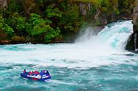 Huka Jet (jet boat) with Huka Falls in background, near Taupo, North Island, New Zealand