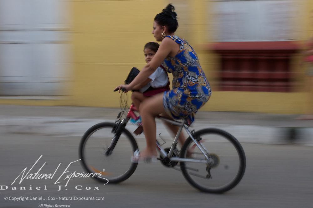 Riding a bike on the streets of Trinidad, Cuba.