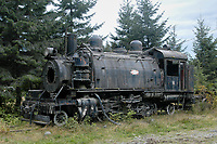 Abandoned locomotive near log sorting station, Telegraph Cove, Vancouver Island, Canada   Photo: Peter Llewellyn
