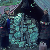 Sherpa women stand outside of a temporary hut they set up as a teahouse along the Mount Everest trail in Lobuche, Nepal,