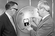 First 20p Coin..1986..29.10.1986..10.29.1986..29th October 1986..At the Central Bank's Currency Centre and Mint the Minister for Finance,Mr John Bruton, was on hand for the issue of the new 20p coin..Initially 20 million new 20p coins will be put into circulation...To commemorate the issue of the new 20p coin,The Minister for Finance,Mr John Bruton TD is presented with the first 20p coin minted.The presentation was carried out by Tomás F. Ó Cofaigh, Governor of The Central Bank