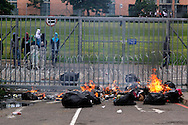 DURBAN - 17 October 2016 - Protesting students at the University of KwaZulu-Natal's Westville campus look on as rubbish they have set alight outside The Oval student residence burns. South Africa's tertiary institutions have been gripped by ongoing violent protests against university fees and a host of other complaints. Note the ironing boards that are used as shields against rubber bullets fired by police. Picture: Allied Picture Press/APP