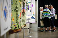 Quilts line the exhibit hall of the 36th Biennial Convention of the Lutheran Women's Missionary League on Friday, June 26, 2015, at the Iowa Events Center in Des Moines, Iowa. LCMS Communications/Erik M. Lunsford