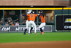 April 13, 2018 - Houston, TX, U.S. - HOUSTON, TX - APRIL 13: Houston Astros left fielder Marwin Gonzalez (9), Houston Astros center fielder George Springer (4) and Houston Astros center fielder Jake Marisnick (6) celebrate after an MLB game between the Houston Astros and the Texas Rangers on April 13, 2018 at Minute Maid Park in Houston, TX.. Houston Astros defeated Texas Rangers 3-2.  (Photo by Juan DeLeon/Icon Sportswire) (Credit Image: © Juan Deleon/Icon SMI via ZUMA Press)