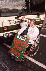 Woman with disability; who is wheelchair user; taking part in protest against inappropriate transport,