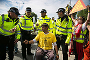 12 local activists locked themselves in specially made arm tubes to block the entrance to Quadrillas drill site in New Preston Road, July 03 2017, Lancashire, United Kingdom. Nick Sheldrick arrested and taken to cout. The 13 activists included 3 councillors; Julie Brickles, Miranda Cox and Gina Dowding and Nick Danby, Martin Porter, Jeanette Porter,  Michelle Martin, Louise Robinson,<br /> Alana McCullough, Nick Sheldrick, Cath Robinson, Barbara Cookson, Dan Huxley-Blyth. The blockade is a repsonse to the emmidiate drilling for shale gas, fracking, by the fracking company Quadrilla. Lancashire voted against permitting fracking but was over ruled by the conservative central Government. All the activists have been active in the struggle against fracking for years but this is their first direct action of peacefull protesting. Fracking is a highly contested way of extracting gas, it is risky to extract and damaging to the environment and is banned in parts of Europe . Lancashire has in the past experienced earth quakes blamed on fracking.