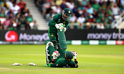 Pakistan's Imam-ul-Haq struggles with cramp during the ICC Cricket World Cup group stage match at Headingley, Leeds.