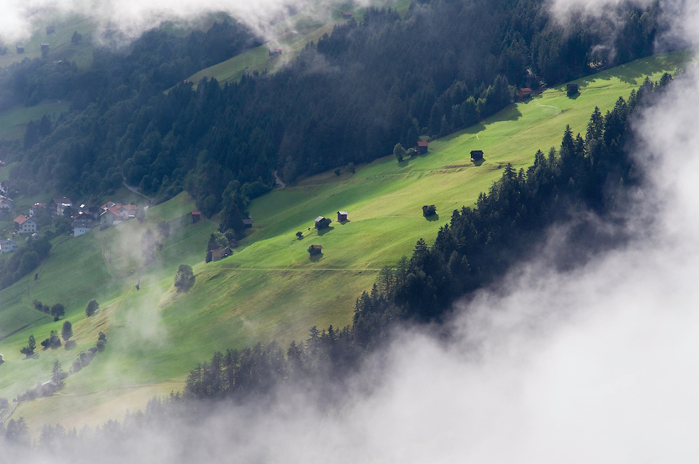 IFTE-NB-007651; Niall Benvie; View into the valley around Fliess from Kaunergrat visitor's centre; Austria; Europe; Tirol; horizontal; green; meadow forest woodland; 2008; July; summer; fog mist rain cloud; Wild Wonders of Europe Naturpark Kaunergrat