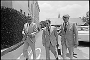 """Convicted of the murder of 102 VietNamese civilians -the My Lai Massacre - former U.S. Army Lieutenant William Calley (sunglasses) is escorted by U.S. Marshals from the Fort Benning, Georgia confinement facility to a federal appeals court in nearby Columbus, Ga. At a later date, Calley's original sentence of life in prison was turned into an order of house arrest, but after three years, President Richard Nixon reduced his sentence with a presidential pardon -- Determine pricing and license this image, simply by clicking """"Add To Cart"""" below --"""