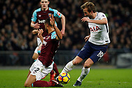Harry Kane of Tottenham Hotspur (R) dodges past a challenge from Winston Reid of West Ham United (L). Premier league match, Tottenham Hotspur v West Ham United at Wembley Stadium in London on Thursday  4th January 2018.<br /> pic by Steffan Bowen, Andrew Orchard sports photography.