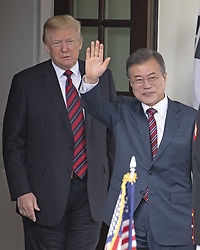 United States President Donald J. Trump looks on as President Moon Jae-in of South Korea waves to the assembled press as he arrives for talks at the White House in Washington, DC, USA on Tuesday, May 22, 2018. The two leaders are meeting ahead of President Trump's scheduled summit with Kim Jung-un of North Korea which is tentatively scheduled for June 12, 2018 in Singapore. Photo by Ron Sachs/CNP/ABACAPRESS.COM