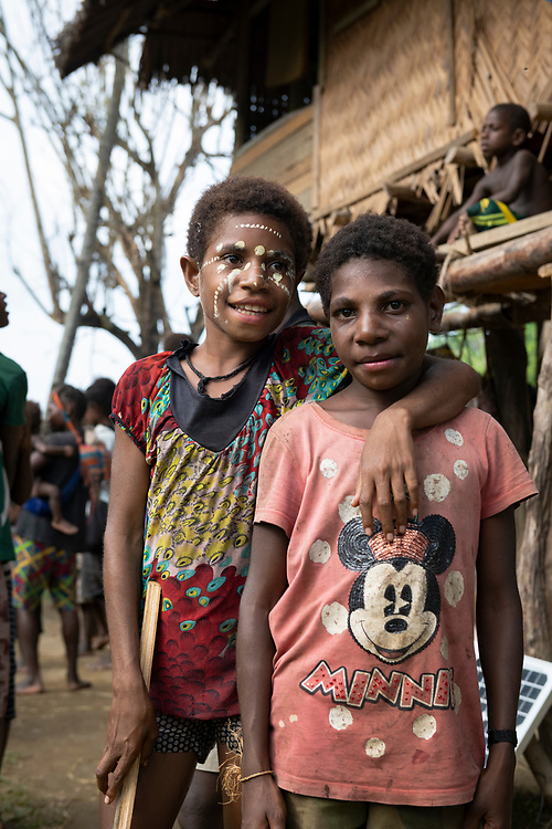 Children in Yar, East Sepik Province, Papua New Guinea. One is wearing a Minnie Mouse shirt.<br /> <br /> (June 21, 2019)