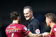 Todays referee Darren Deadman sees the funny side with Bradford City midfielder Romain Vincelot (6)  during the EFL Sky Bet League 1 match between Scunthorpe United and Bradford City at Glanford Park, Scunthorpe, England on 26 March 2017. Photo by Simon Davies.