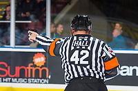 KELOWNA, CANADA - SEPTEMBER 29: Referee Clayton Hall makes a call at the Kelowna Rockets against the Everett Silvertips on September 29, 2017 at Prospera Place in Kelowna, British Columbia, Canada.  (Photo by Marissa Baecker/Shoot the Breeze)  *** Local Caption ***