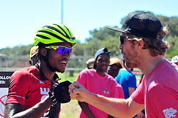 CAPE TOWN, SOUTH AFRICA - MARCH 18: Accomplished racer William Mokgopo on the left after the 20km prologue at UCT on Table Mountain on March 18, 2018 in Cape Town, South Africa. Mountain bikers from across South Africa and internationally gather to compete in the 2018 ABSA Cape Epic, racing 8 days and 658km across the Western Cape with an accumulated 13 530m of climbing ascent, often referred to as the 'untamed race' the Cape Epic is said to be the toughest mountain bike event in the world. (Photo by Dino Lloyd)