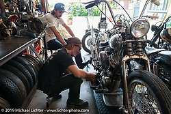 Cycle Zombies' Scotty and Turk Stopnik work in Scotty's garage. Huntington Beach, CA. USA. June 29, 2015.  Photography ©2015 Michael Lichter.