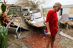 August 27, 2017 - Port Aransas, Texas, U.S.- Port Aransas resident MELANIE ZURWASKI stands in her backyard where a boat and other debris came to rest in the aftermath of Hurricane Harvey. Zurwaski's home was destroyed but she managed to get through the category four storm. (Credit Image: © Kin Man Hui/San Antonio Express-News via ZUMA Wire)