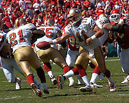 San Francisco quarterback Alex Smith (11) hands off the running back Frank Gore (21) in the first half against the Kansas City Chiefs at Arrowhead Stadium in Kansas City, Missouri October 1, 2006.  The Chiefs beat the 49ers 41-0.