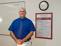 """Principal Jim McCullom stands alongside the Sachem Nation """"Pride"""" sign in one of their newly renovated Math Wing classrooms at Laconia High School.  (Karen Bobotas/for the Laconia Daily Sun)"""