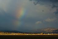 Distant rainbow over  Susanville, Lassen County, California
